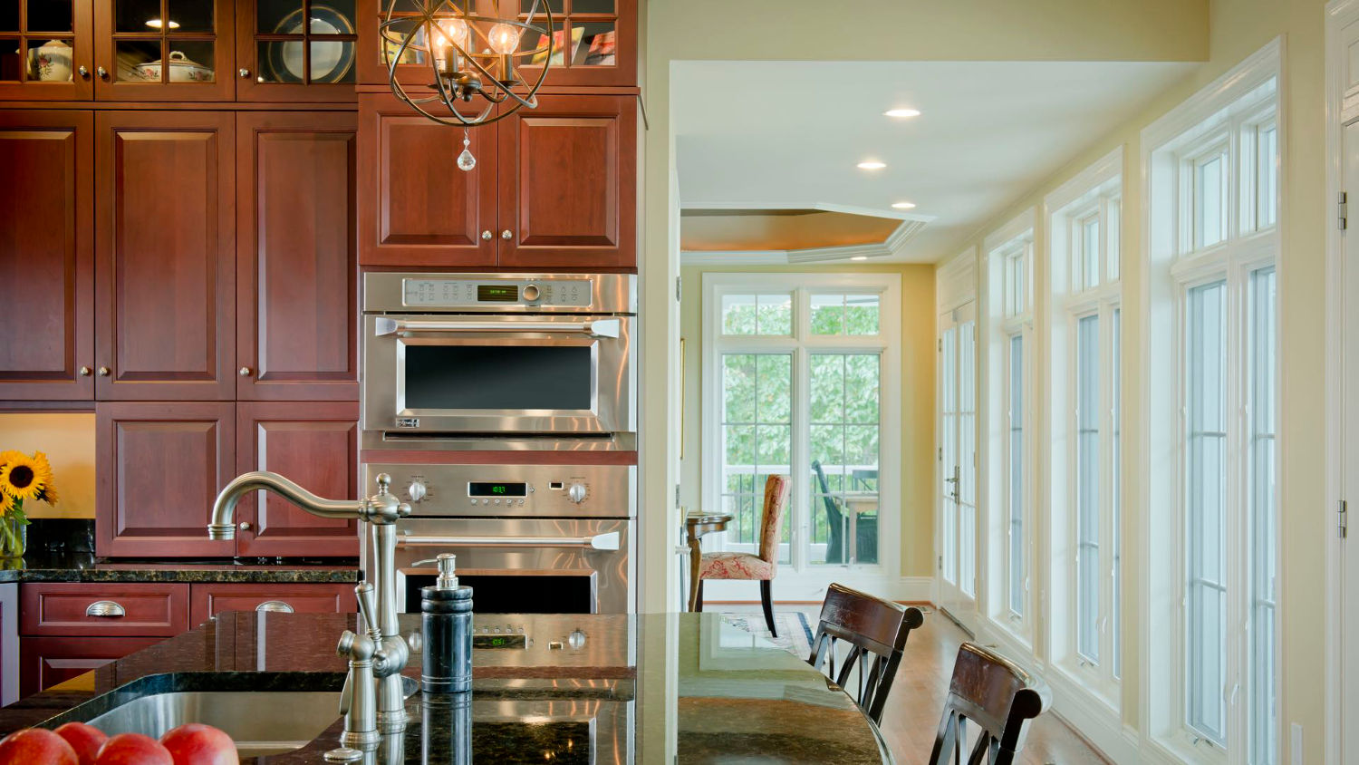 Bright kitchen renovation in whole house remodel of country estate in Baltimore. Wall of windows open up breathtaking rear views