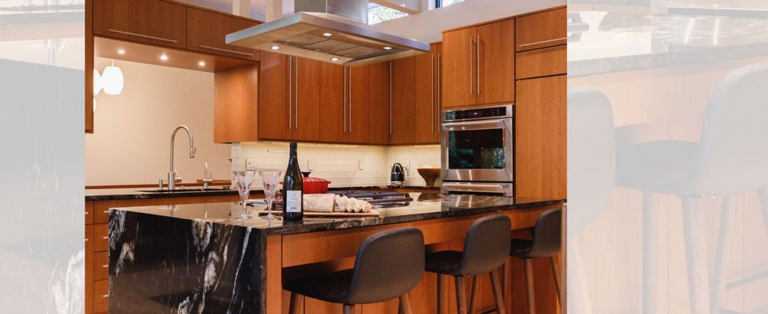 black-granite-waterwall-counter-modern-kitchen-1100x450.jpg