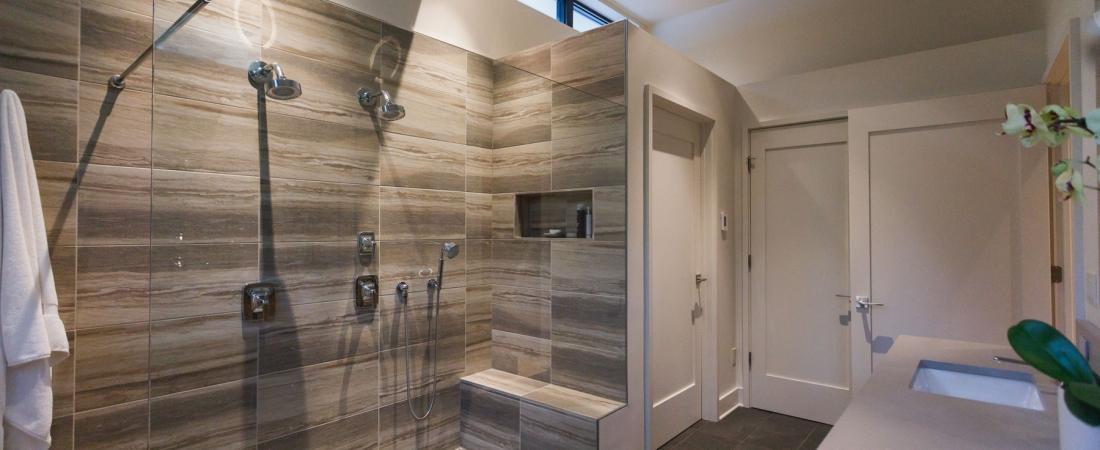 master-bath-luxury-two-head-open-side-glass-shower-river-rock-1100x450.jpg