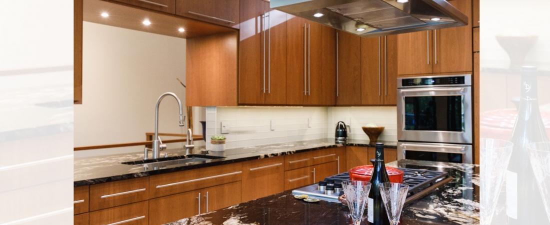 open-modern-kitchen-mahogany-cabinets-black-granite-1100x450.jpg