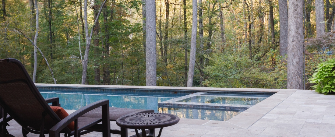 pool-with-wooded-view-stone-patio-1100x450.jpg