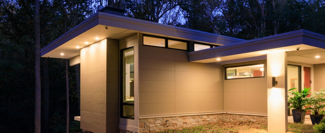 side-view-sloping-to-pool-modern-home-1100x450.jpg
