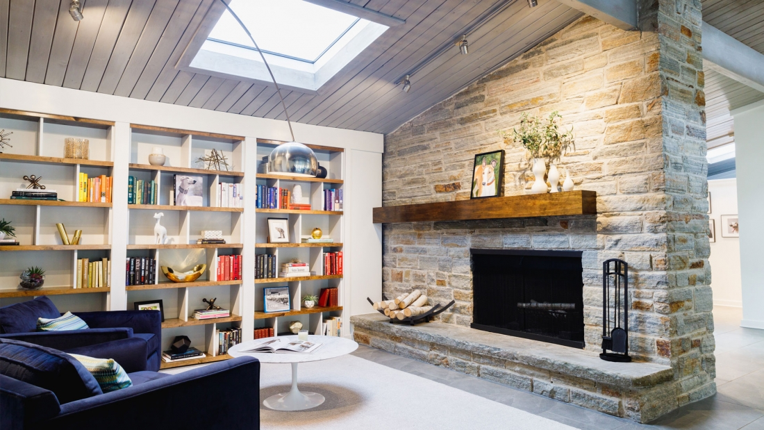 fireside-library-exposed-stone-live-edge-bookshelves-1100x619.jpg