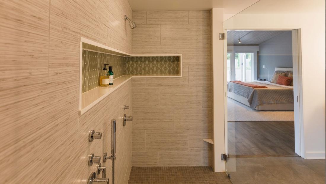 master-bath-family-shower-product-shelf-90-degree-wraparound-1100x619.jpg