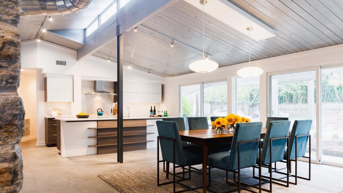 sleek-modern-kitchen-renovation-wood-tones-industrial-ceiling-1100x619.jpg