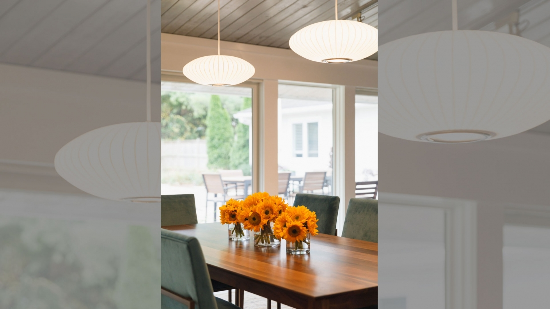 wall-of-windows-dining-room-vaulted-ceiling-1100x619.jpg